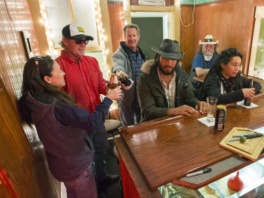 Guests toast at the Room 4 Bar in Bisbee, Ariz. March