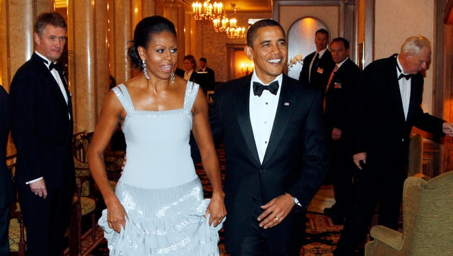 Nobel peace prize laureate, US President Barack Obama (R) and First Lady Michelle Obama (C) arrive to the Nobel Banquet in Oslo on December 10, 2009. US President Barack Obama today accepted the Nobel Peace Prize, uncomfortably acknowledging his role as a leader at war while insisting that conflict can be morally justified. AFP PHOTO/ LISE ASERUD /Scanpix (Photo credit should read LISE ASERUD/AFP/Getty Images)