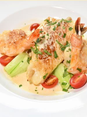 Thai Sea Bass with sauteed jumbo shrimp and scallops is one of Surin of Thailand's special entrees.