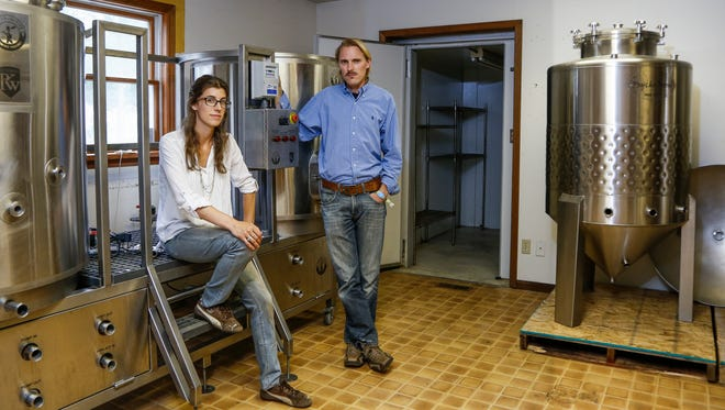 Chad and Michelle Rogers in the future home of Dimes Brewhouse in downtown Dimondale, which slated to open in late December 2016.  The two got the idea to start a brewery when taking a brewing and distilling class at Michigan State University.