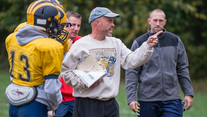 Climax-Scotts's head football coach Kevin Langs works with players during a recent practice.