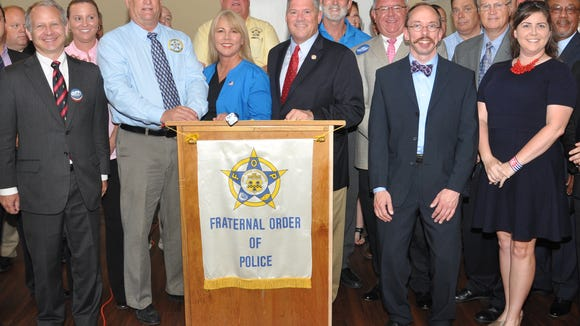 Mayoral candidate Bill Freeman, in middle wearing blue sports coat, stands next to Metro Council  candidates endorsed by the Nashville Fraternal Order of Police.