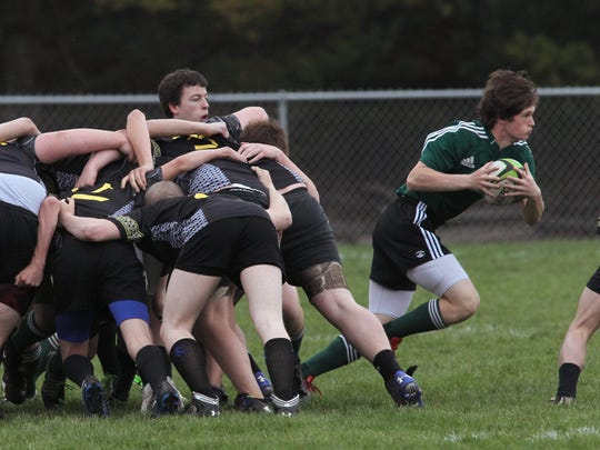 A Wausau player sprints away from a scrum as the then
