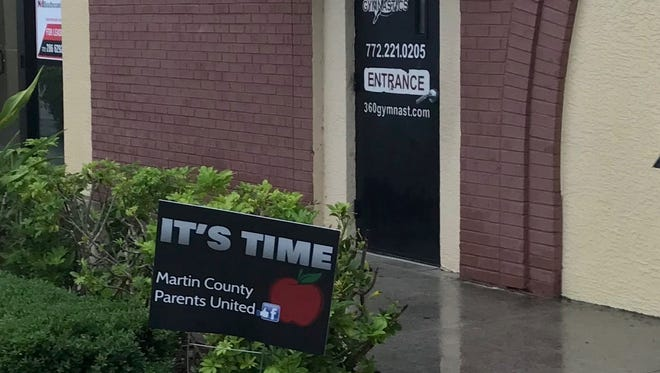 "A Martin County Parents United ""It's Time"" sign graces the entrance to 360 Gymnastics in Stuart."