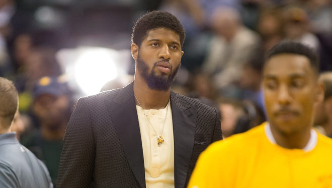 Nov 18, 2016; Indianapolis, IN, USA; Indiana Pacers forward Paul George (13) looks on during warm ups prior to the game against the Phoenix Suns at Bankers Life Fieldhouse. The Phoenix Suns beat the Indiana Pacers 116-96.