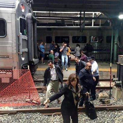 Passengers rush to safety after a NJ Transit train