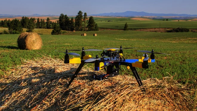 This July 2013 photo shows a multi-rotor hexacopter, an unmanned aircraft that Robert Blair purchased to monitor his farm in Kendrick, Idaho.