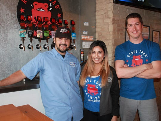 Rebel Toad Brewing owners, Hector Cavazos (from left), Nathali Cavazos, and head brewer Sean Sutherland at the tap room on William Street in downtown Corpus Christi Feb. 1, 2018.