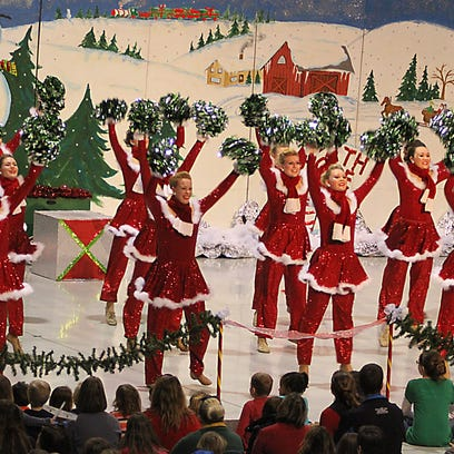 Julie's Touch of Silver dancers entertained before a crowd in the Eagle Hangar at the EAA's Christmas in the Air in 2014.