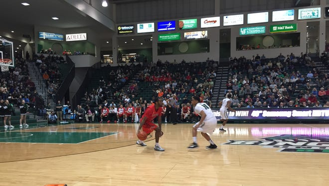 Hartford's Justin Graham dribbles the ball while Binghamton's Yosef Yacob defends.