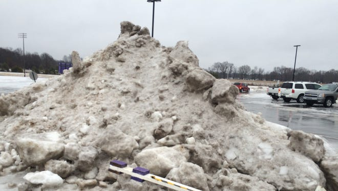 A seven-feet tall pile of snow sits outside Crisp Arena on Saturday afternoon as Bethel University's basketball teams and the District 13-A tournament championship were set to be played.