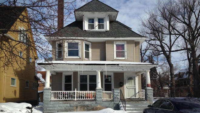William Williams, 34, the brother of Cleveland's police chief, Calvin Williams, was found dead of a bullet wound to the head in this house on Cleveland's East Side.
