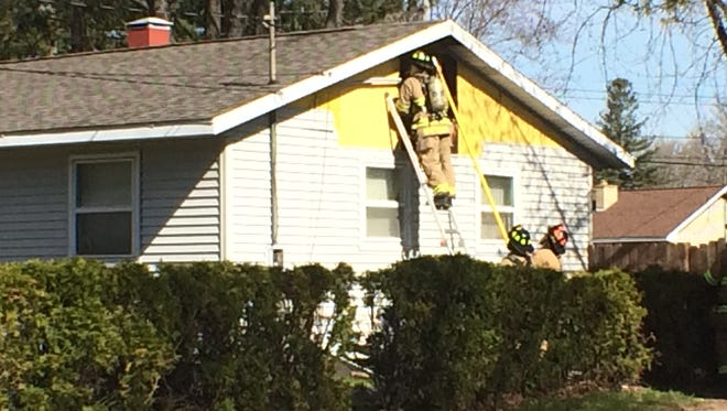 Firefighters at the scene of a house fire in the 500 block of Grove Avenue in Wisconsin Rapids on Tuesday morning.