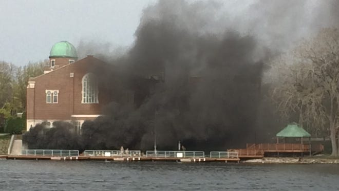 Black smoke billows from a patio on the lower level of the Student Center at St. Norbert College in De Pere on Sunday.