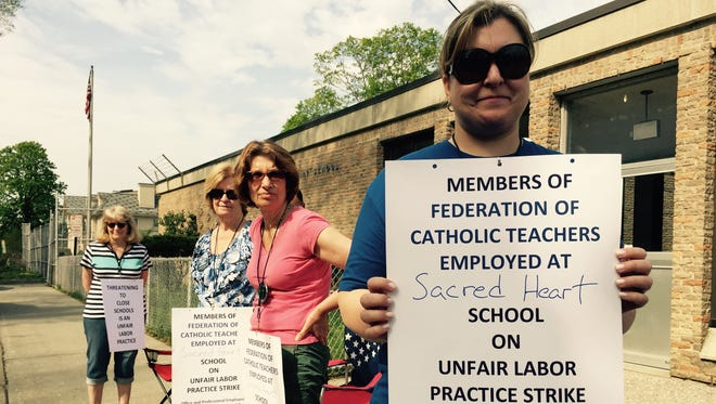 Danielle Burgio and other teachers stand outside Sacred Heart School in Hartsdale during a one-day strike May 5, 2015, to protest what they call unfair labor practices by the New York Catholic Archdiocese.