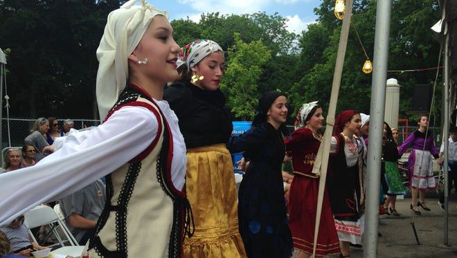 Irini Konstantinou, 14, of Williamson, Wayne County, leads a traditional dance at the Greek Festival 2015 in Rochester on May 30, 2015.