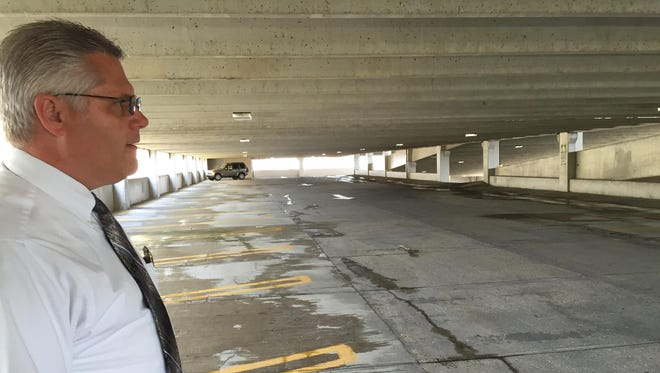 Lt. Donnie Benedict of the Richmond Police Department's traffic division shows improvements to the city parking garage,  including a recent hose-down by the Richmond Fire Department.