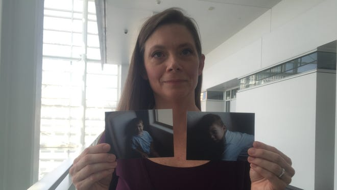 Ryan Monje's mother, Beth Monje, holds up photos of him before he swallowed beads from an Aqua Dots toy, which seriously injured him. The family was awarded $435,000 in damages on Thursday, June 18, 2015, after suing.