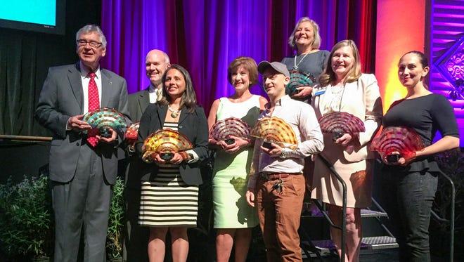 The 2015 Asheville Area Chamber of Commerce Award winners pictured, from left to right: Jan Davis, Paul Vest, Jenny Parmar Disson (accepting on behalf of William Dissen), Karen Tessier, Adam Charnack, Karen Cragnolin, Sharon Owen, Ilana Craig Alberico.