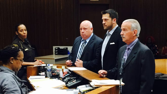 Former Detroit Tigers pitcher Evan Reed enters his plea to misdemeanor aggravated assault on Friday, July 17, 2015, with attorneys Ben Gonek, left, and Steve Fishman.