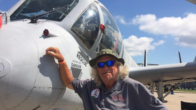 Larry Easter, senior crew member in care of the Mohawk OV-1D, stands with the plane that serves as a flying memorial to Vietnam veterans.