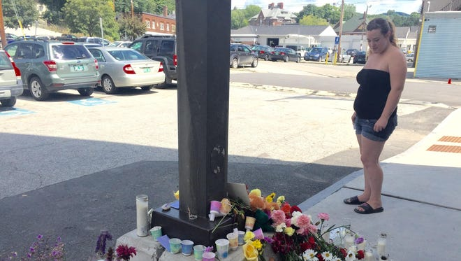 Tila Lissor, a client of the Department for Children and Families in Barre, visits a memorial for social worker Lara Sobel on Monday.