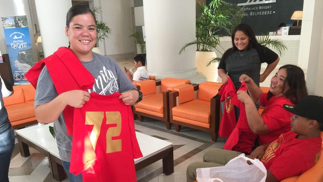The Lady Guahan go through team uniforms prior to the welcoming cermonies of the Guam Women's Baseball Cup at the LeoPalace Resort