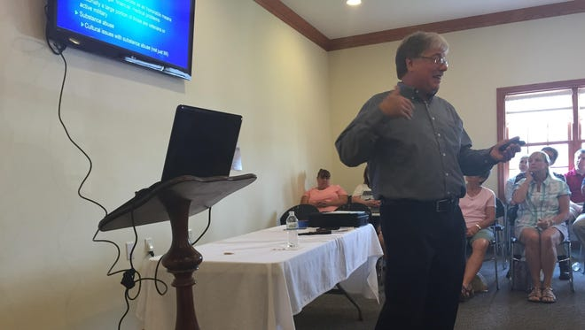 Manitowoc County Coroner Curtis Green discusses drug-related deaths at his presentation, Tuesday, Aug. 18 at Pfeffer Funeral Home's All Care Cremation Center.