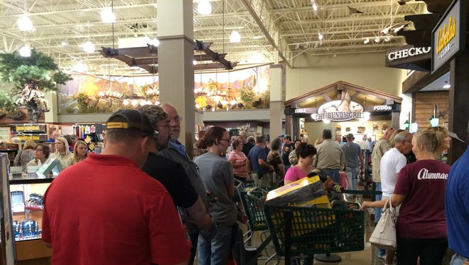 Eager shoppers check out the new Cabela's store Thursday in Noblesville.