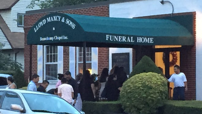 People attend a wake for Shirley Lojano, a 10-year-old girl killed by an SUV, at Lloyd Maxcy & Sons Beauchamp Chapel Inc. funeral home in New Rochelle Thursday night.