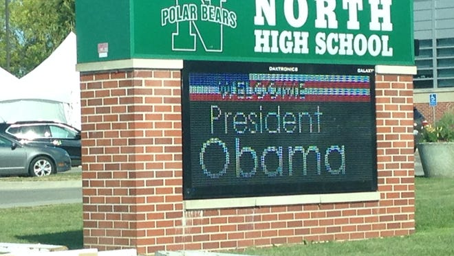 A sign outside Des Moines' North High School welcomes President Obama to the school.