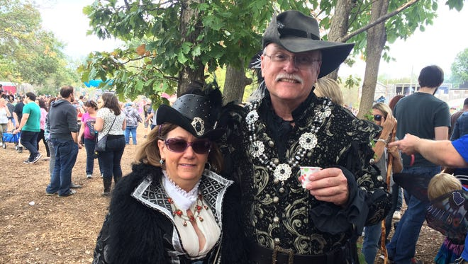 Leslie Becker, 62, and Tim Bennett, who turns 70 on Thursday, from Saranac sample meads on Sunday, Sept. 20, at the 37th annual Michigan Renaissance Festival in Holly. The two have been coming to the event since 1992 and plan to attend every weekend in 2015.