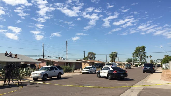 Neighbors watch as Tempe police canvas the area.