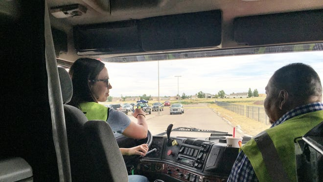 Truck driving student Jamey Roberts, left, gets advice from commercial driver's license program instructor Bear Gallineaux in the parking lot at Great Falls College Montana State University last summer.