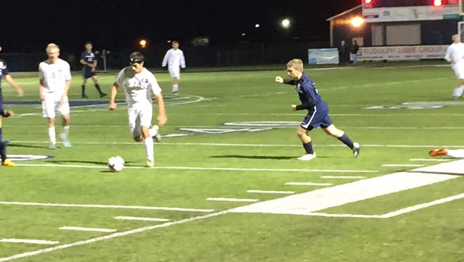 Genoa's Jack Ford dribbles the ball Monday against Napoleon.