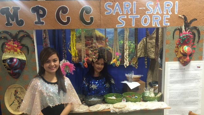 Charlotte Tolentino and Maria Spragg volunteered at the Mabuhay Philippine Cultural Community Booth at the Indy International Festival, Saturday, Nov. 7, 2015.