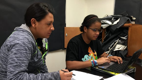 Andress High School seniors Kristina Armendariz, left, and Brianna McDonald research telescopes in a dual-credit astronomy class.