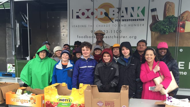 Volunteers distribute food at a Kraft Mobile Food Pantry at the Parker Elementary School in Mount Vernon.
