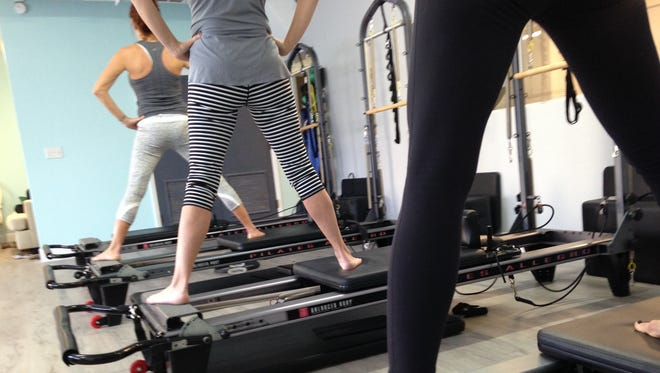 This is a small-group Pilates Reformer class at Pilates on Fifth in Indialantic. Mixing in use of  equipment such as the Reformer and the chair increases the challenge and delivers faster results.