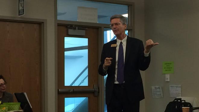 University of Iowa Provost P. Barry Butler gives a talk on wind energy at the Johnson County Health and Human Services Building on Thursday.