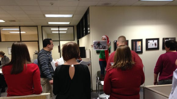 York Newspaper Company faculty members cast guesses during holiday movie trivia.