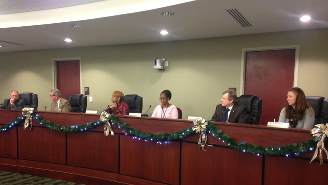 From left to right, York City Councilman David Satterlee, council vice president Henry Nixon, council president Carol Hill-Evans and council members Michael Helfrich and Renee Nelson discuss the city's proposed 2016 budget with city business administrator Michael Doweary at the Dec. 15 council meeting. In between Hill-Evans and Helfrich is Dianna Thompson-Mitchell, council clerk. Council members plan to unveil a new budget proposal Dec. 28. They have until Dec. 31 to finalize a spending plan for 2016.