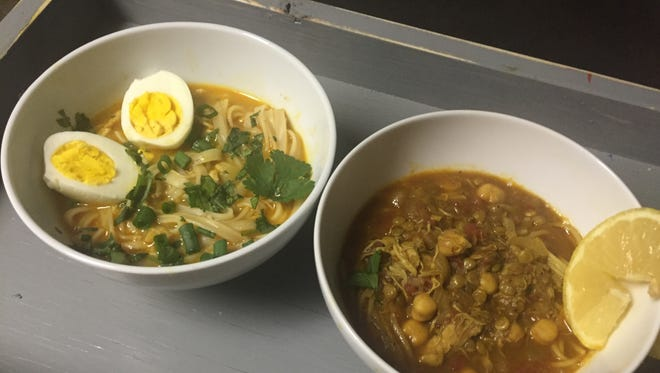 A pair of chicken noodle soups from different continents.
