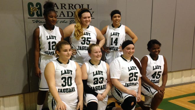 Carroll Academy players pose for a team picture. Swearingen (23) and Vargo (25) are in the middle of the front row.