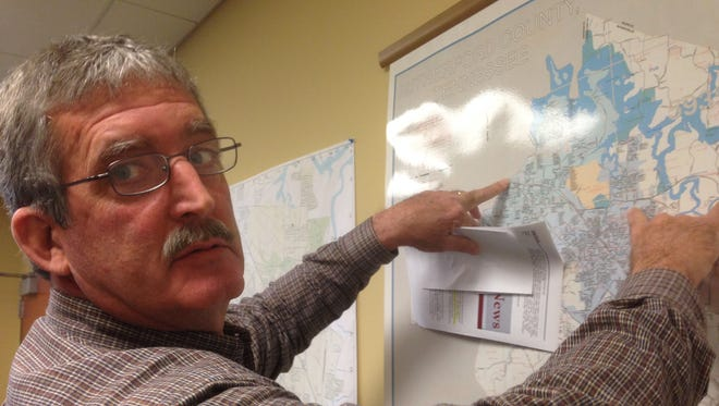 Rutherford County Road Superintendent Greg Brooks points to a map where crews could start a nearly $1.2 million Fate Sanders Bridge rehabilitation project on Weakley Lane north of Smyrna.