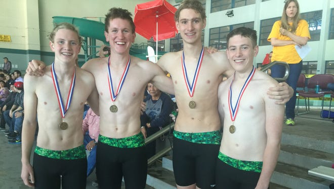 Farmington's district-record breaking 200-yard freestyle team of Marshall Magunson (far left), Jebediah Pinckley, Trenton Grossheim and Ethan Larson pose for a photo on Saturday at the District 1 championships in Santa Fe.