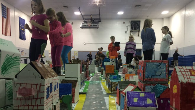 Third-grade students at Fishers Elementary School spent two days planning and building a box city of Fishers.