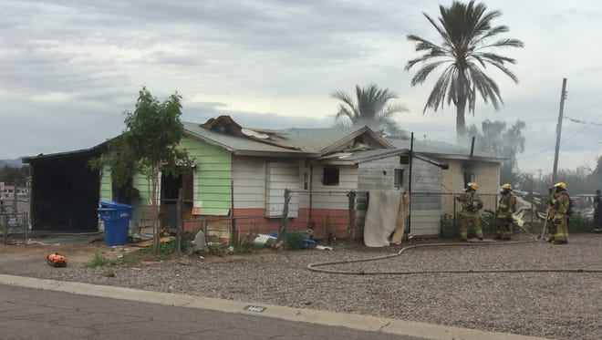 An abandoned house near 13th Street and Buckeye Road in Phoenix was severely damaged after being engulfed in flames Feb. 18, 2016.