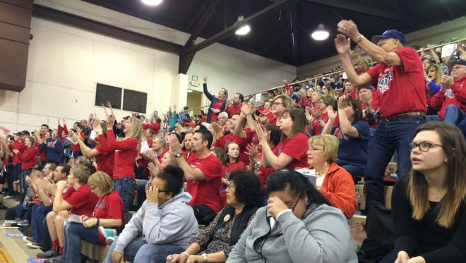 Kennedy fans cheer on the girls basketball team Saturday night in the state championship game.