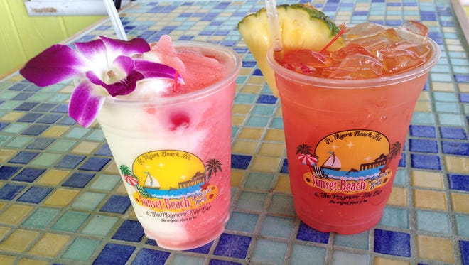 Pictured with a rumrunner, the Miami Vice at Playmor Tiki Bar is half pina colada, half strawberry daiquiri and all beach tropical frozen goodness.